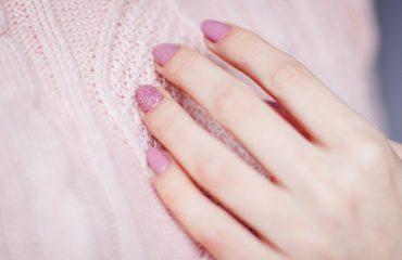 pink painted fingernails