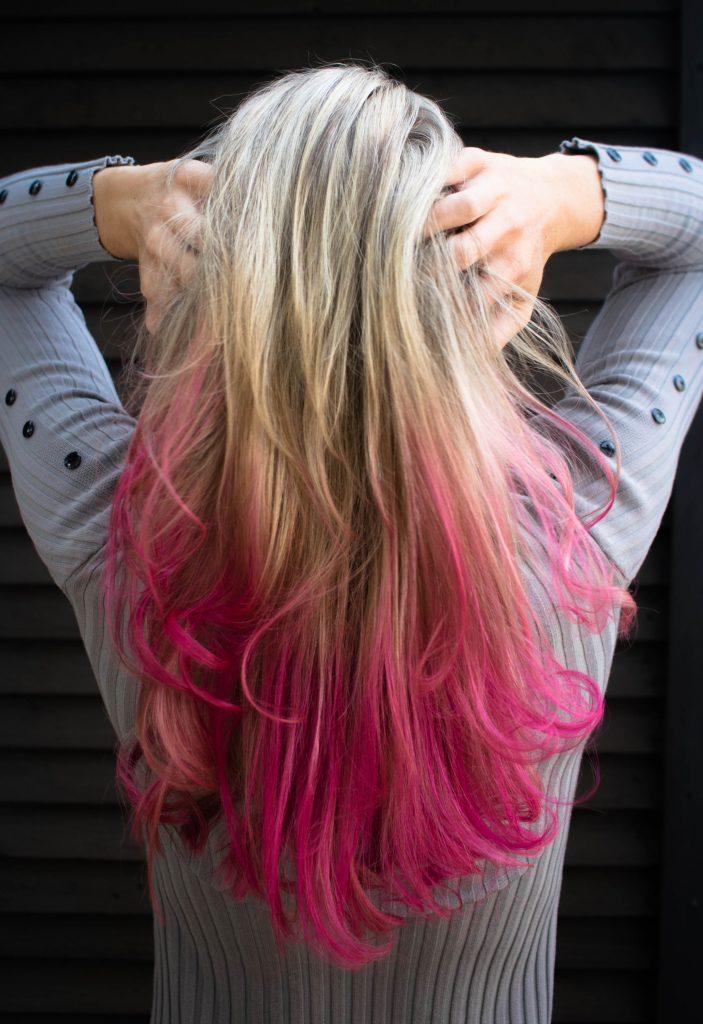 Blonde to pink balayage stock photo