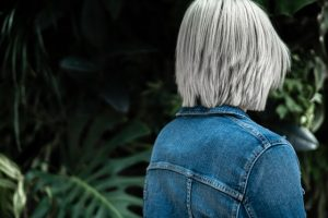 silver haired woman with a bob facing away from the camera