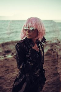 stock photo of a woman with pastel pink hair