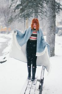 red haired woman in the snow