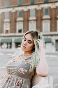 stock photo of a woman with mint green hair.