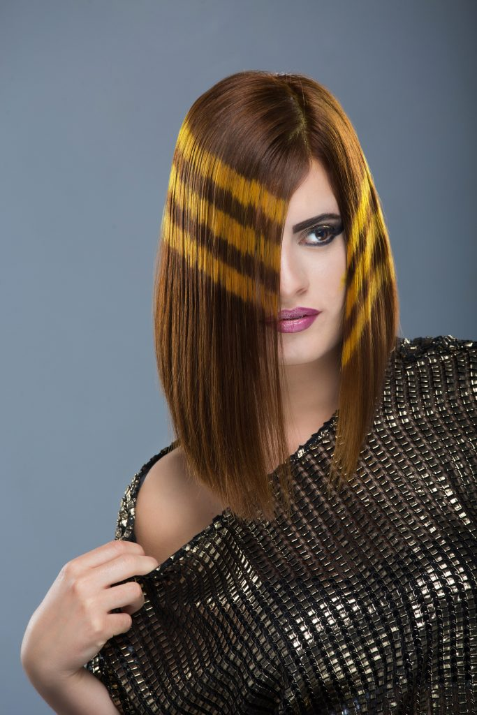 Attractive lady with yellow striped hair.