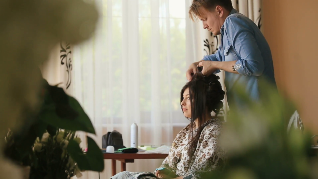 professional hair stylist at work on a client