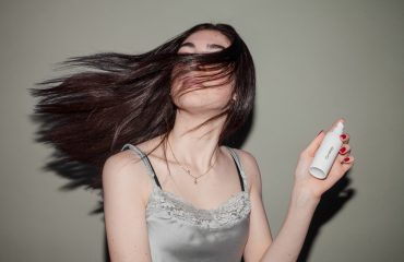 woman with hair product